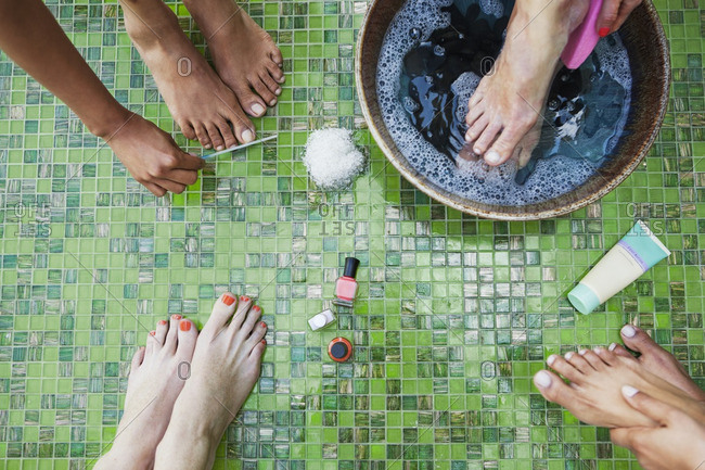 Low section of friends doing pedicure