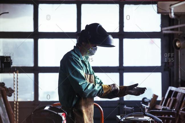 Man wearing protective work wear in workshop