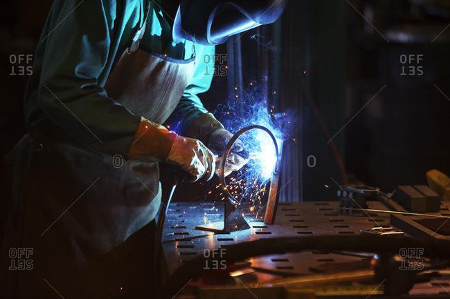 Manual worker welding in workshop