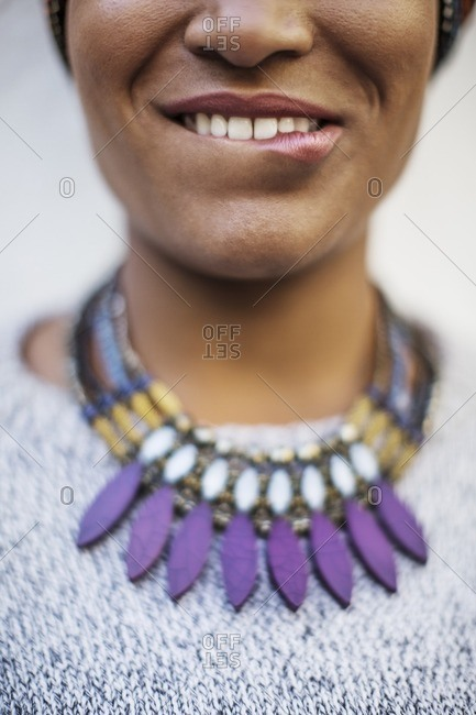 Close-up midsection of woman biting lips