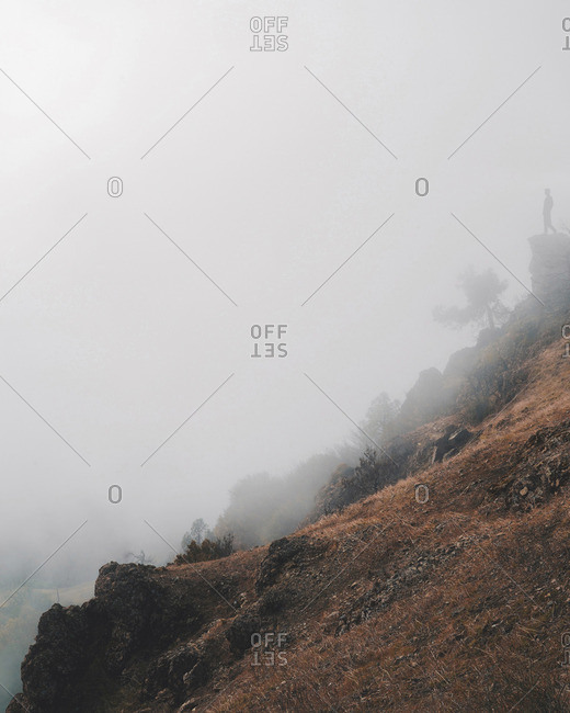 Scenic view of rock formation during foggy weather