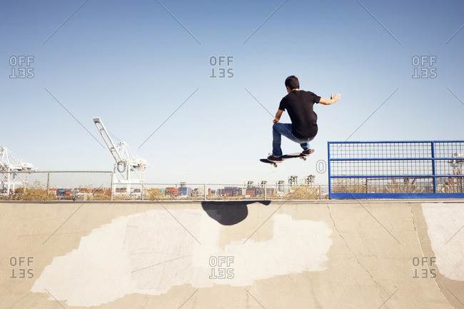 Low angle view of man performing stunt in skateboard park