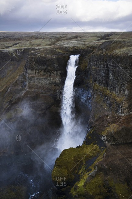 Scenic view of Haifoss waterfall against cloudscape