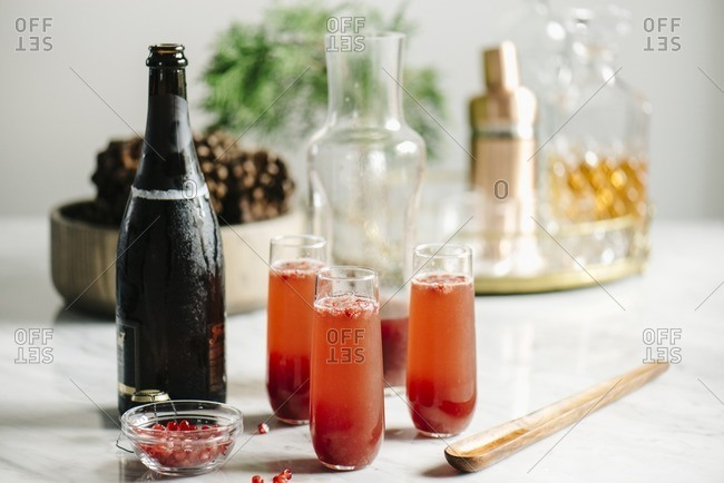 Cocktail with pomegranate and champagne on kitchen island