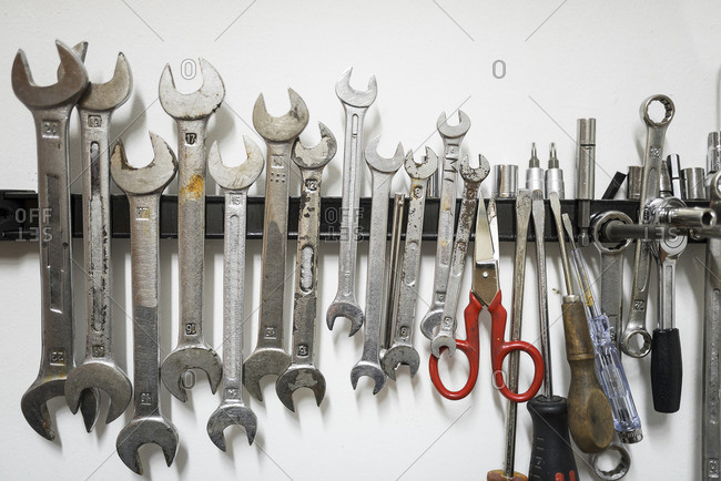 Close-up of work tools on magnet at workshop