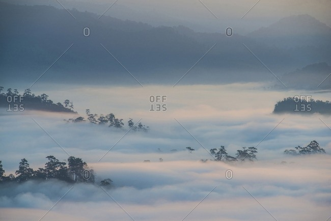 Scenic view of cloudscape covering mountain at morning