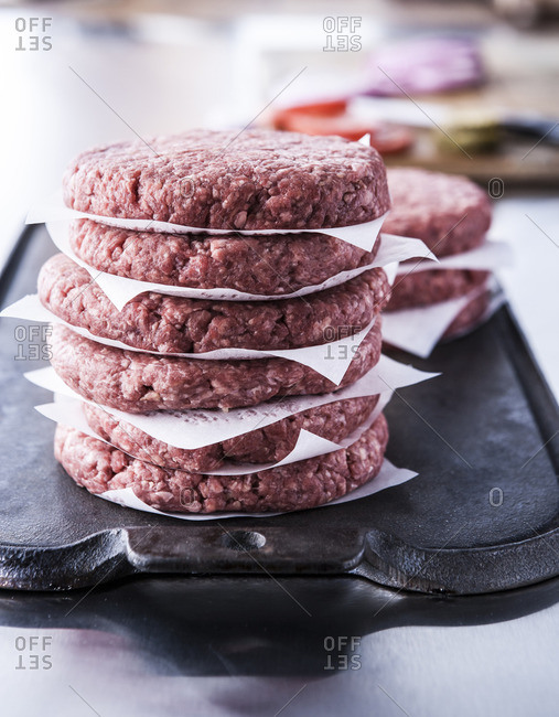 Stack of raw lean ground beef hamburger patties