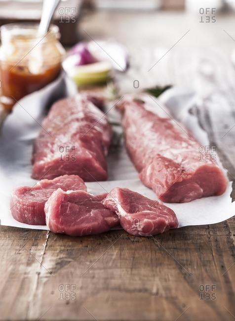 Raw pork tenderloin on butcher paper