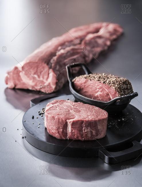 Raw beef tenderloin with pepper coating