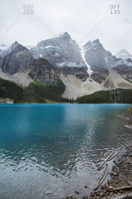 Lake at foggy mountain