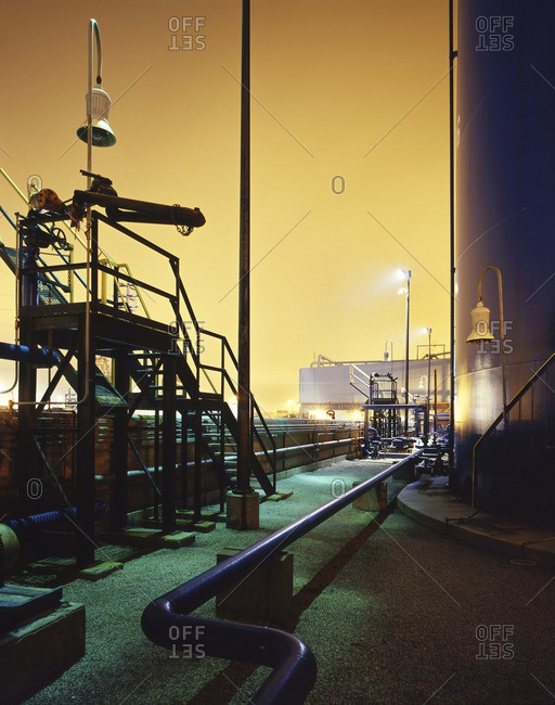 Blue industrial pipes and storage tank