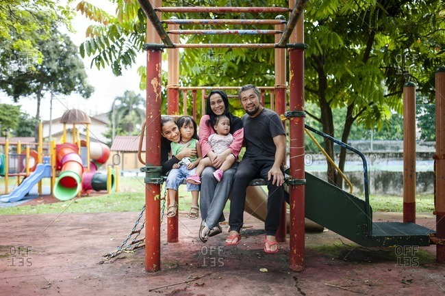 Family of five on jungle gym