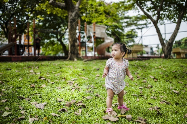Toddler girl standing by playground