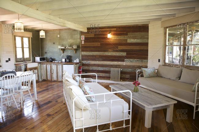 Villa la Angostura, Argentina - March 1, 2016: Seating and kitchen area in rustic hotel