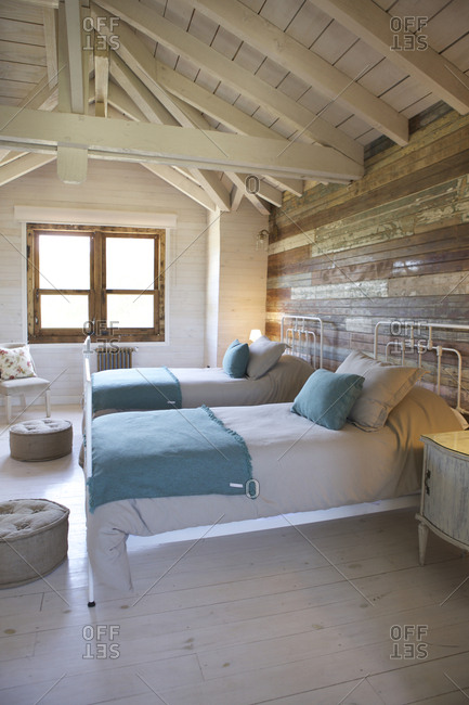 Cozy beds in a rustic hotel