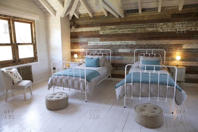 Cozy beds in rustic hotel