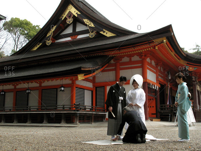 Kyoto, Japan - March 21, 2009: Couple being posed for a wedding photograph