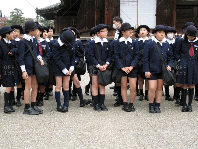 Kyoto, Japan - March 22, 2009: Students outside Sanjusangen-do temple