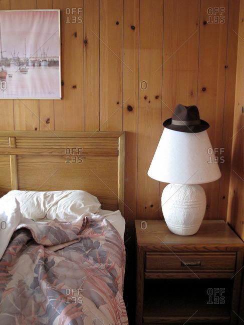 Hat on lamp in motel room