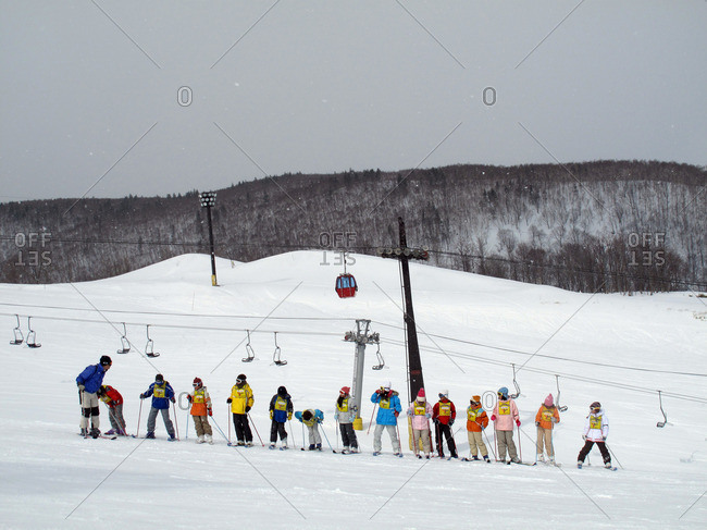 Hirafu, Japan - March 26, 2009: Kids lined up for ski school