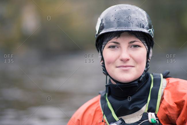Portrait of young female kayaker in watersports helmet