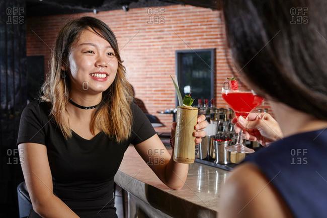 Friends in bar making a toast