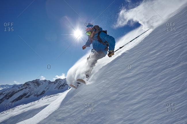 Male freestyle skier skiing down mountainside, Zugspitze, Bayern, Germany