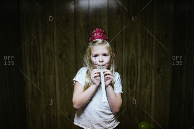Girl with New Year's eve party favors