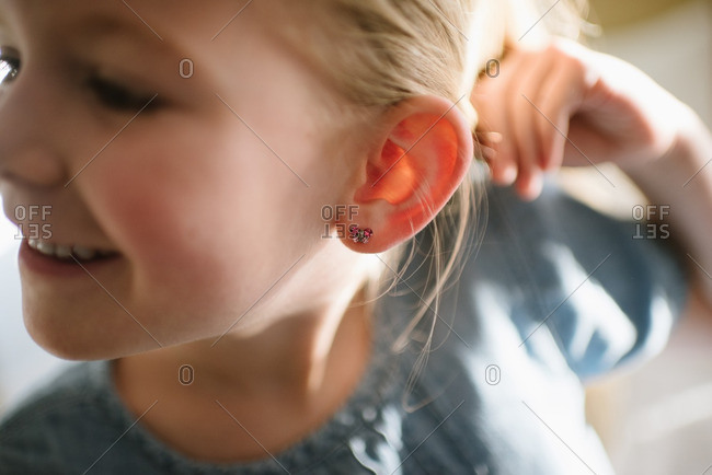 Girl showing off her earring