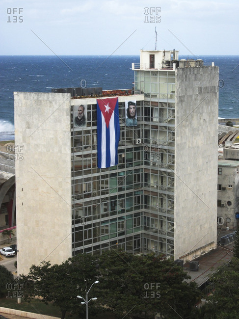 High angle view of building with posters and Cuba flag against sea