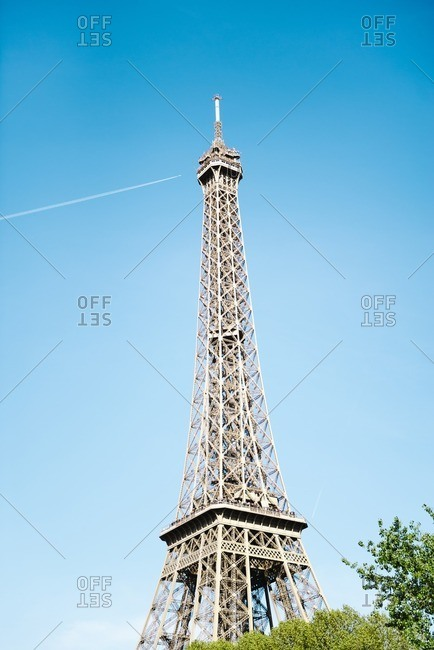 Low angle view of Eiffel Tower against blue sky on sunny day