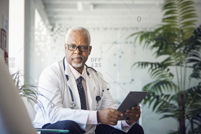 Portrait of doctor with tablet computer in hospital
