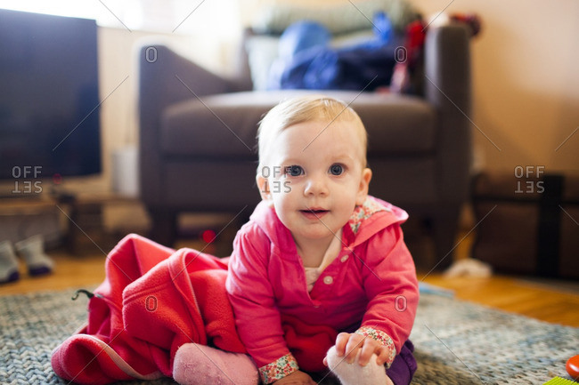 Portrait of cute boy sitting on floor at home