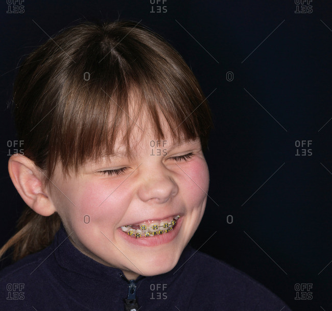 Girl smiling, braces showing, close-up