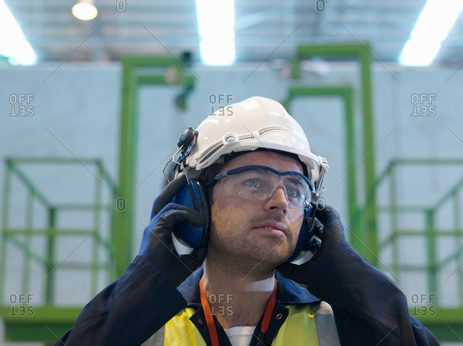 Worker With Protective Clothing
