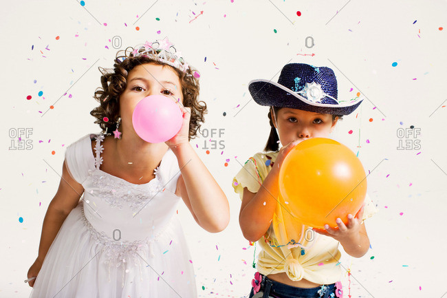 party girls blowing balloons