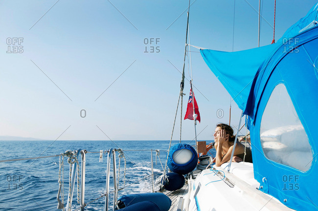 Woman Relaxing on Sailing Boat