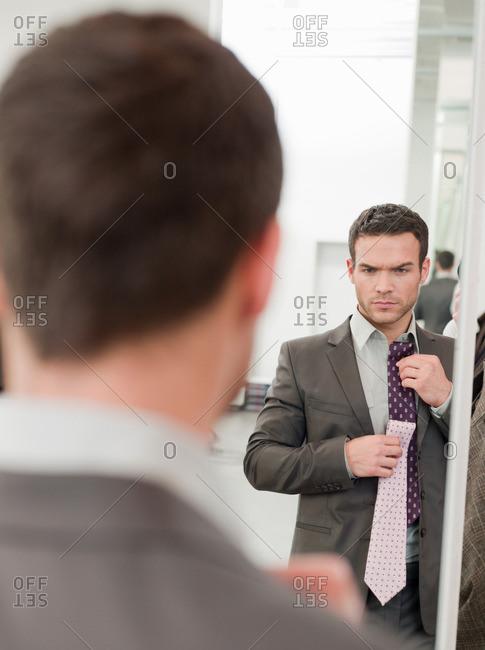 man shopping comparing ties