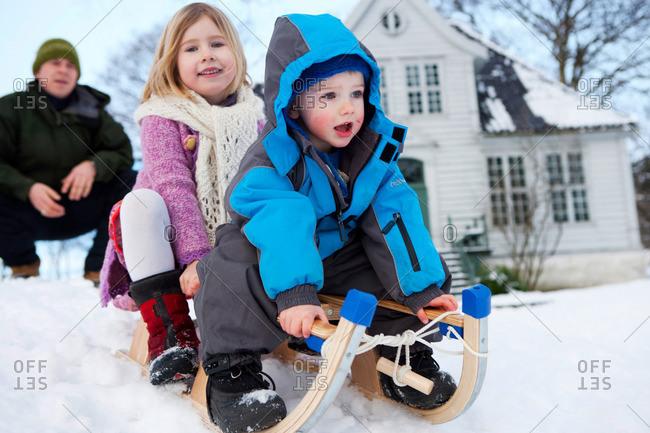 Scandinavian children on a sled