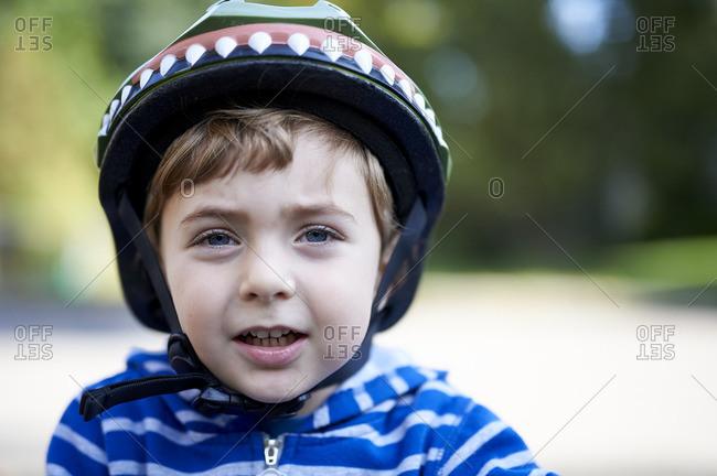 Portrait of blue eyed boy wearing helmet