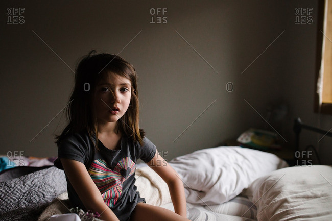 Girl sitting up on bed