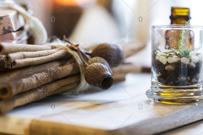 Close-up of   cinnamon sticks on wooden board at herbalist shop