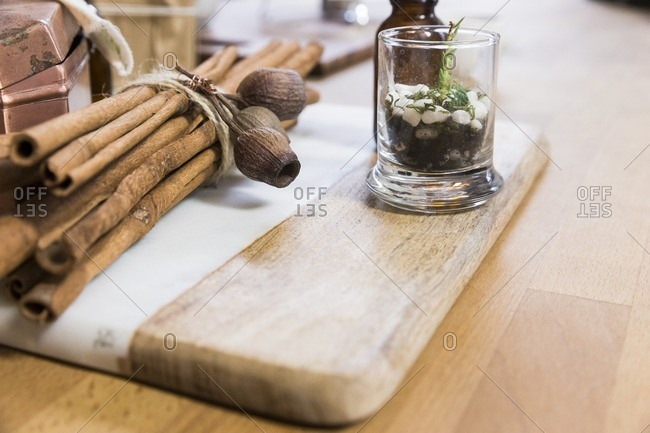 Cinnamon on wooden board at herbalist's shop