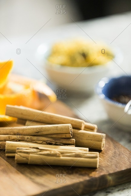 Cinnamon sticks and citrus rind on wooden board
