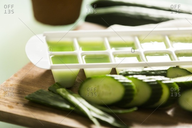 Cucumber aloe vera juice to be frozen in ice cube tray for treating sunburn