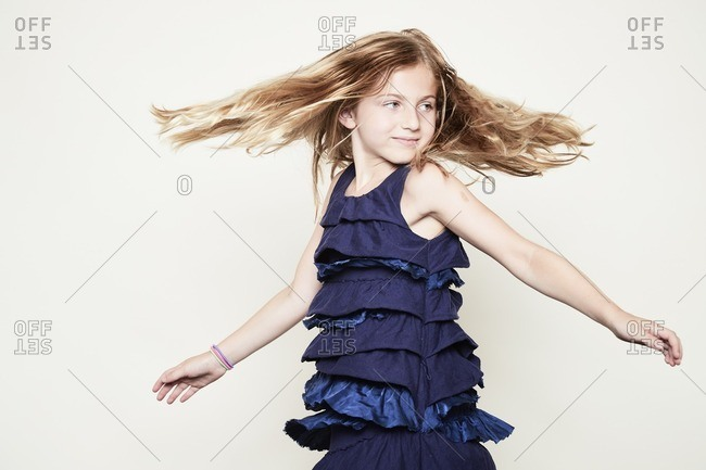 Twirling girl with arms outstretched
