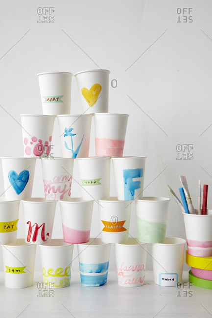 Tower of handmade party cups with tape and pencils