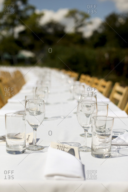 Glasses on long table for an outdoor dinner party