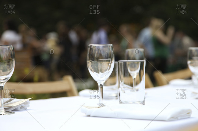 Close up of glasses on table for an outdoor dinner party