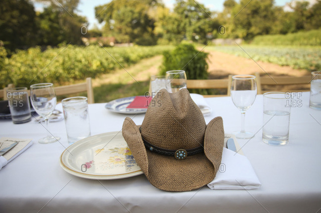 Cowboy hat on table at outdoor dinner on a farm